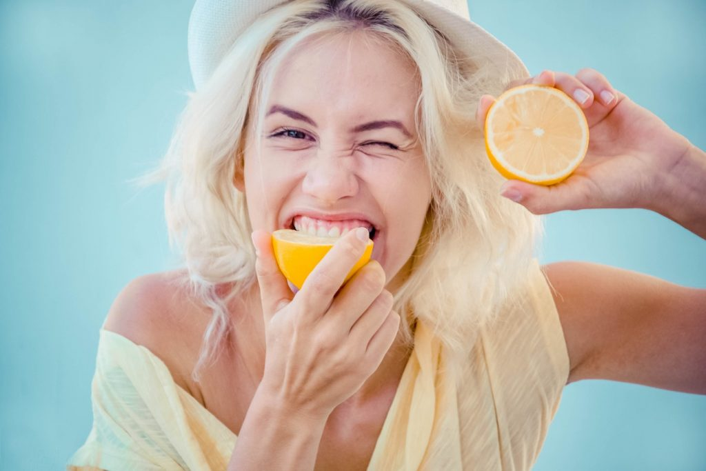 girl eating lemon