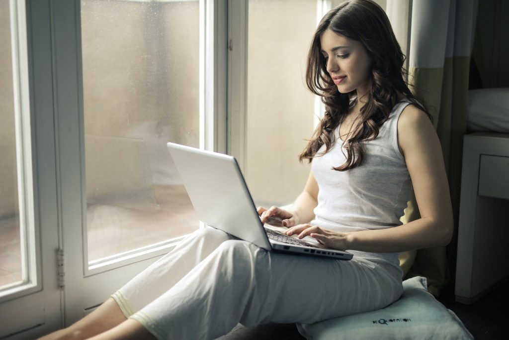 girl reading lap top